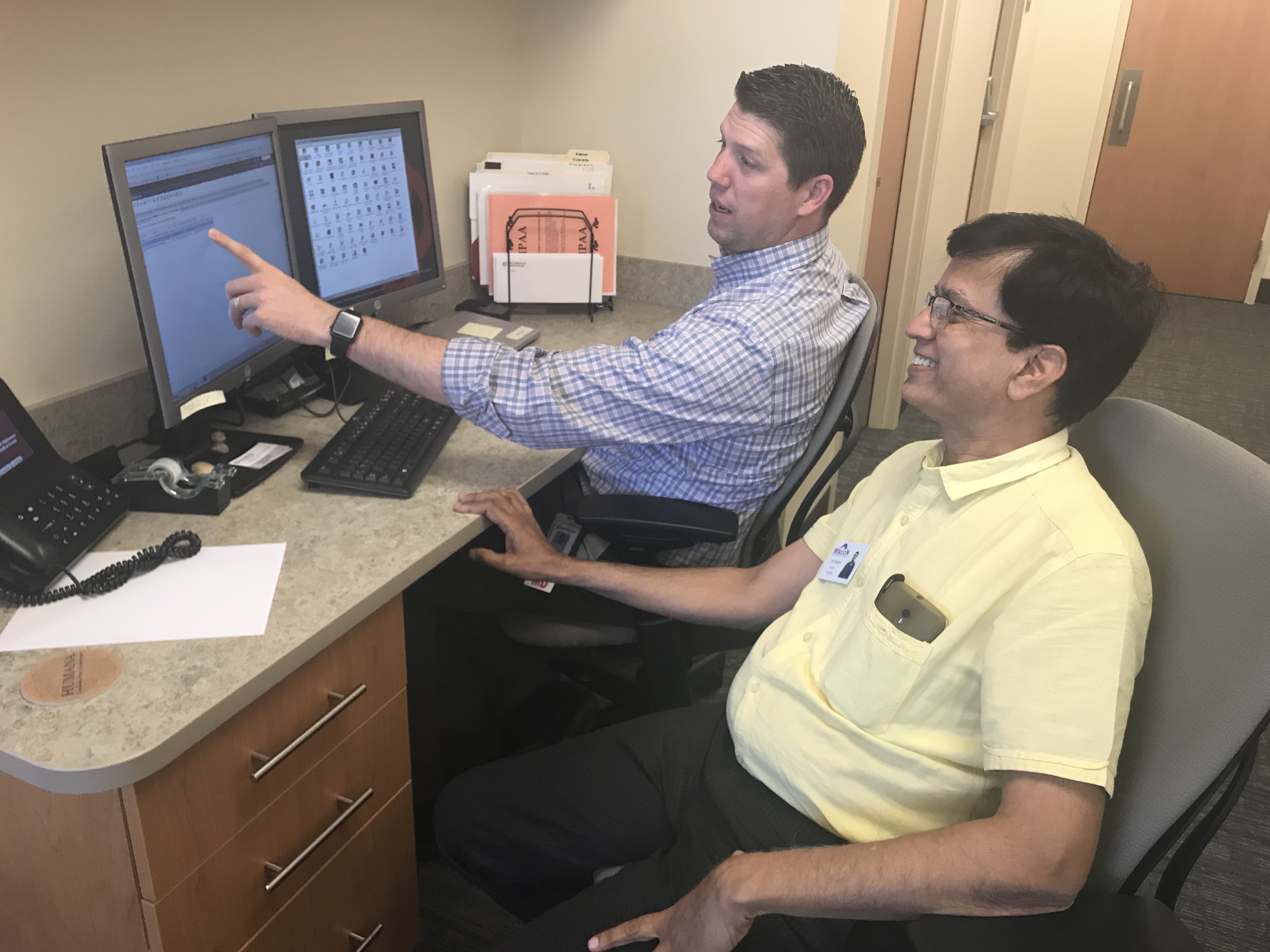 Dr. Walker from Horizon helping to train Dr. Tripathi in Meridian, ID.
